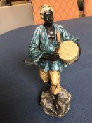 Frank Bergmann, Edwardian cold painted bronze depicting an African drummer standing on