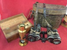 A cased pair of wartime Carl Zeiss Jena binoculars, the leather case with pair of smoked glass