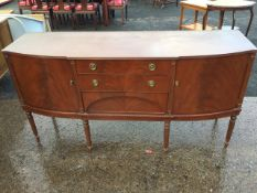 A reproduction mahogany sideboard, the shaped top with ribbed edge above three central drawers,