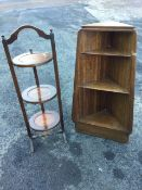A 60s tapering mahogany corner unit with three graduated shelves; and an oak cakestand with arched