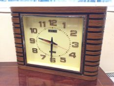 An Odeonesque electric clock by Eurosonic, the quartz movement with copper numerals in ribbed faux