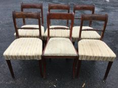 A set of six regency mahogany dining chairs, the tablet moulded backs above turned & twisted joining