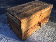 A rectangular nineteenth century pine box with tin lining having metal mounts, complete with key. (