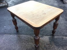 An oak draw-leaf dining table, the rounded panelled top raised on fluted turned column legs. (41.