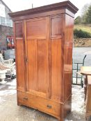 A late Victorian mahogany wardrobe with moulded cornice above a moulded panelled front with