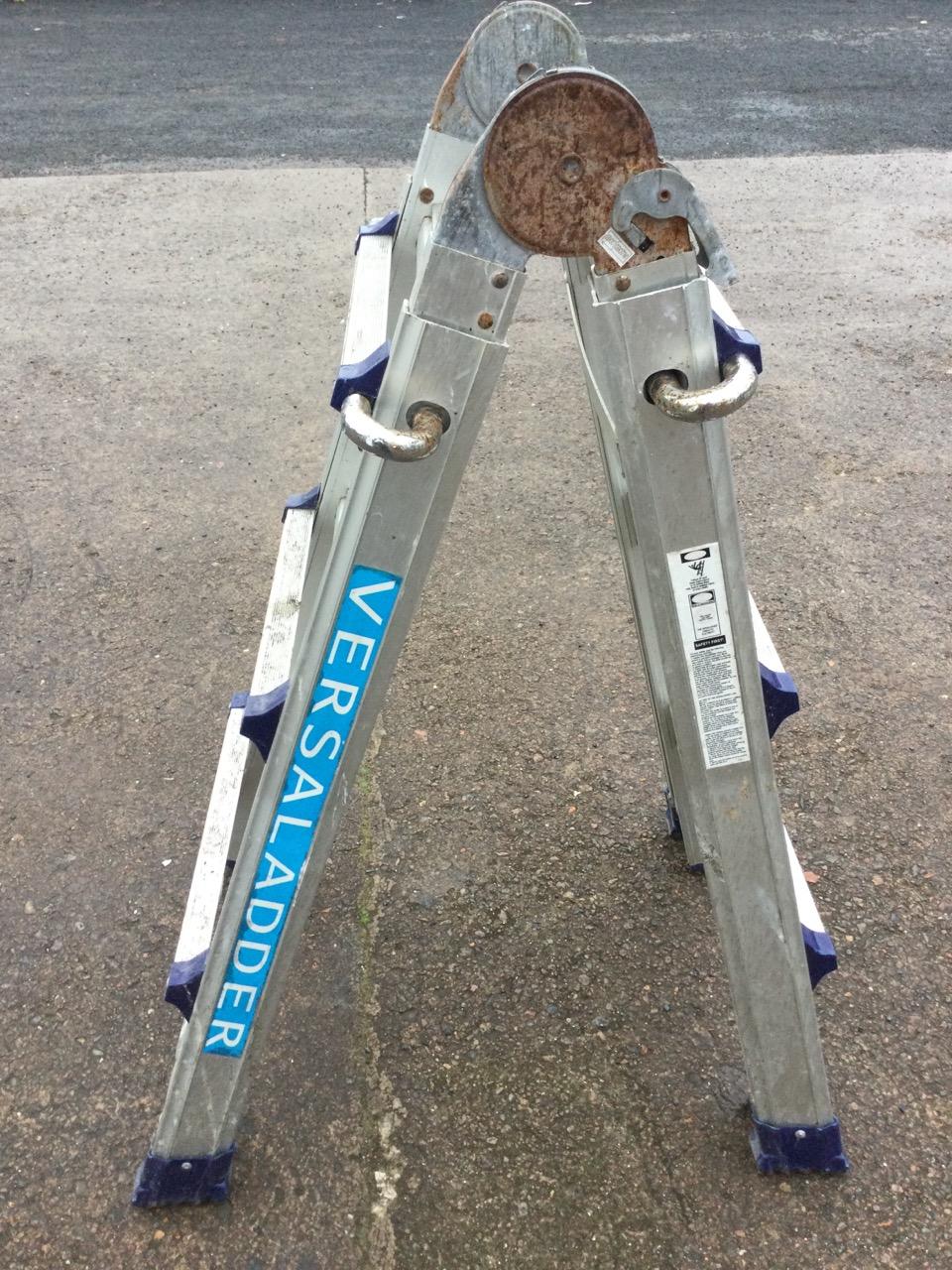 An aluminium Versal extending & folding ladder with ribbed treads.