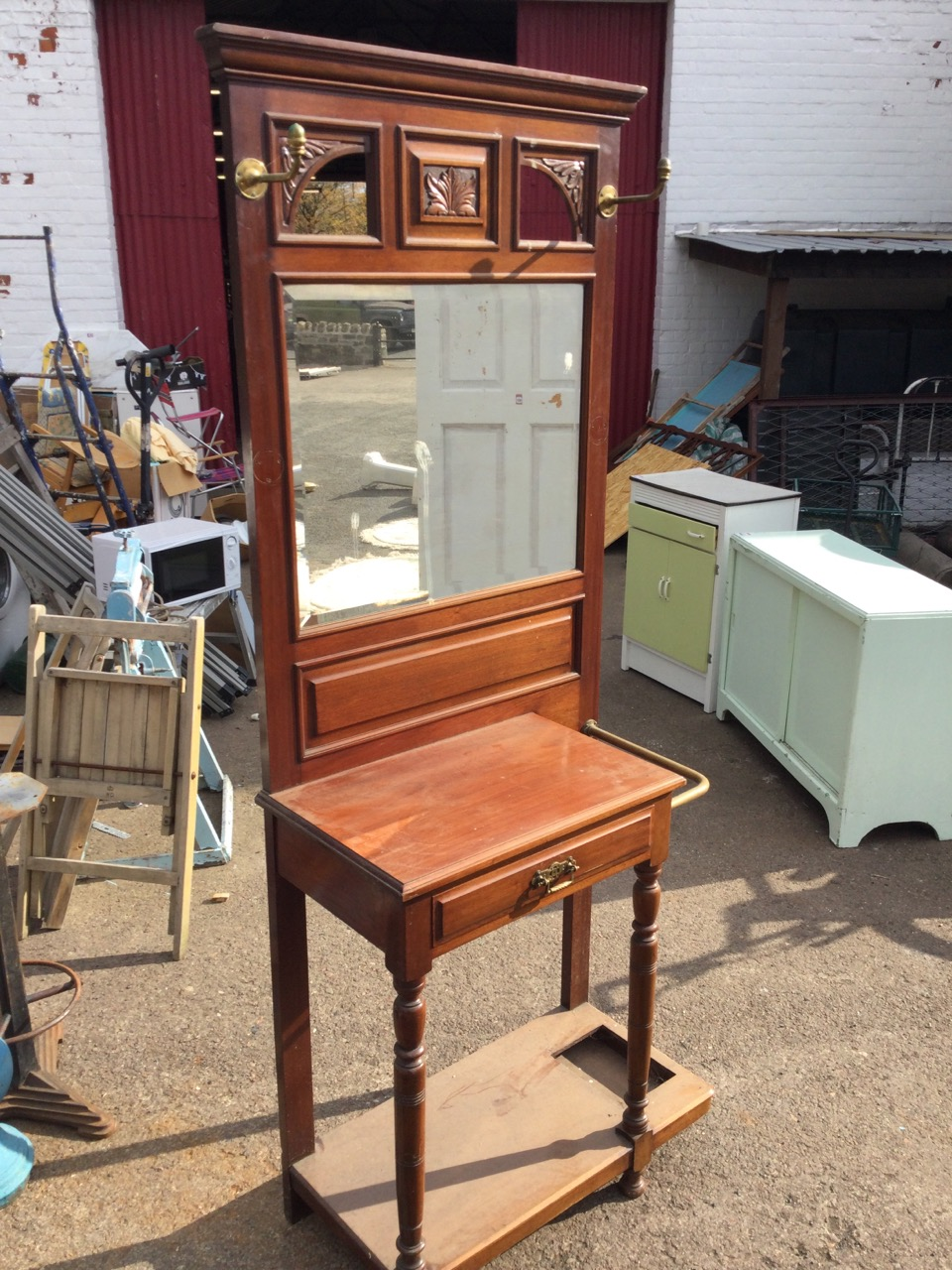 A late Victorian mahogany hallstand with moulded cornice above three leaf carved frames with - Image 2 of 3
