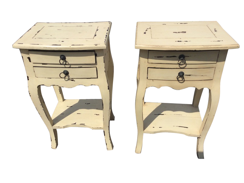 A pair of painted bowfronted bedside tables, the panelled moulded tops above two small drawers
