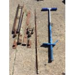 A childs pogo stick; a fibreglass spinning rod; and a set of gate strap hinges with crooks. (A lot)
