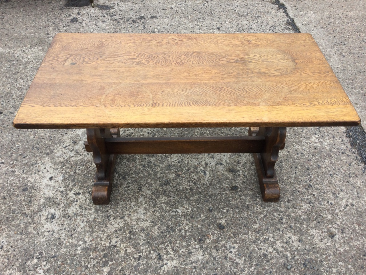 A rectangular oak coffee table on pierced trestle style supports joined by pegged stretcher, with - Image 2 of 3