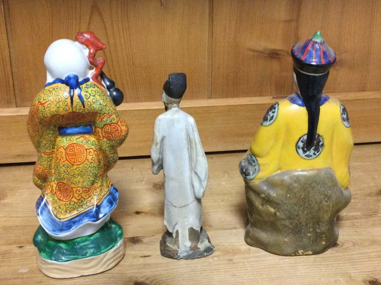 A seated Chinese stoneware figure; a porcelain figure of a bearded immortal in kimono; and a - Image 3 of 3