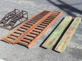 A pair of 7ft welded angleiron ribbed ramps for 12in tyres; a pair of 5ft 6in forklift extensions;