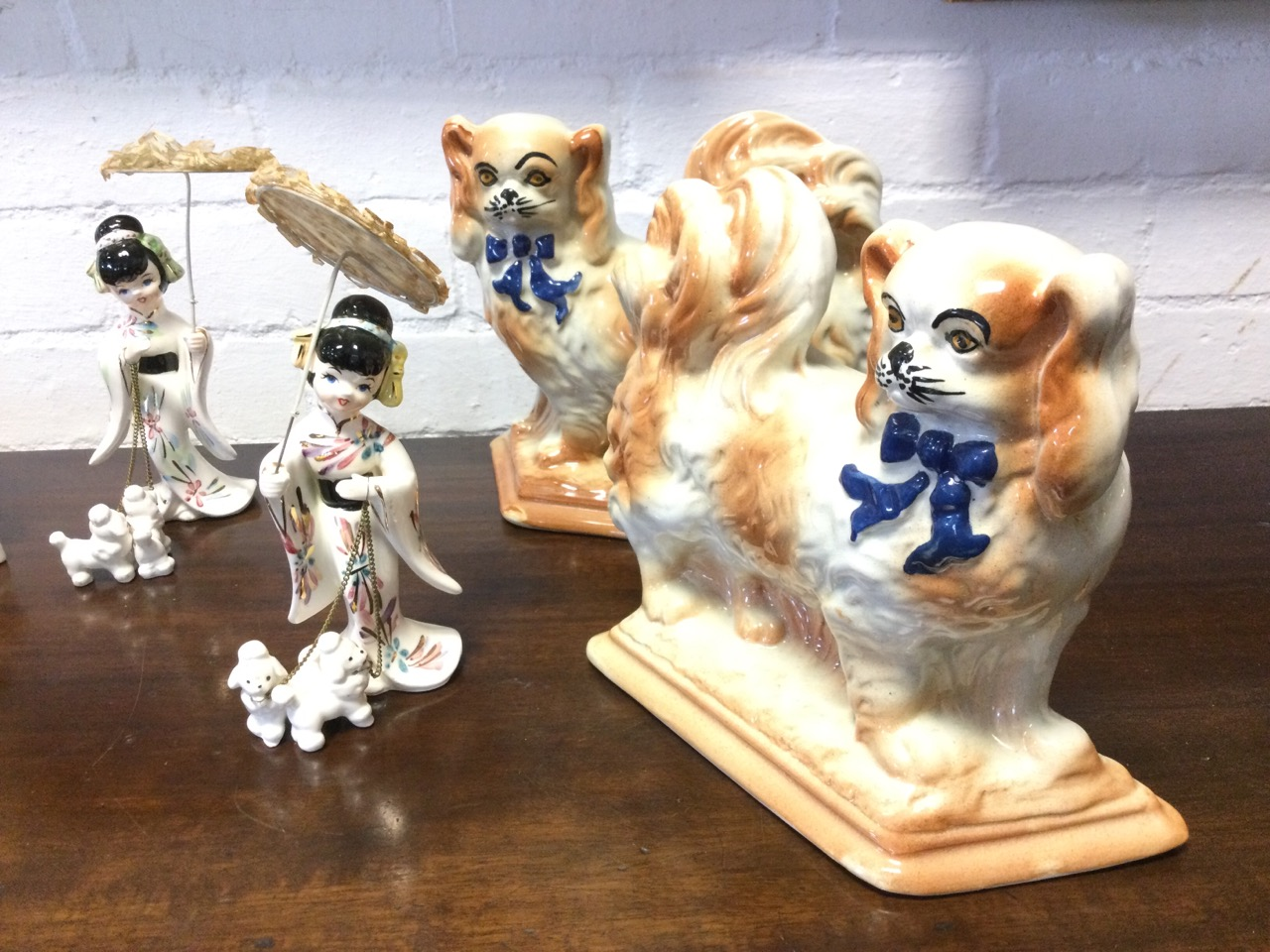 Four pairs - Japanese girls with parasols & dogs, Royal Art Pottery spaniels by baskets, boy & - Image 3 of 3