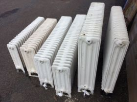 Six miscellaneous cast iron radiators, the panels on angled legs - various heights & lengths, and