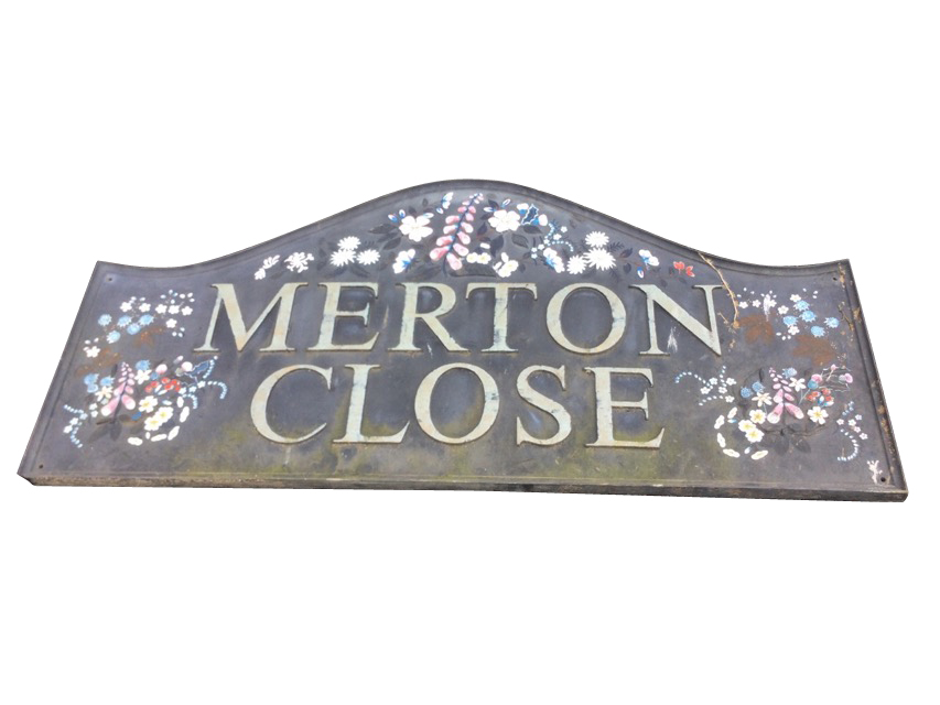 A rectangular sign handpainted & moulded in relief with flowers, in moulded frame. (56in x 26.5in)