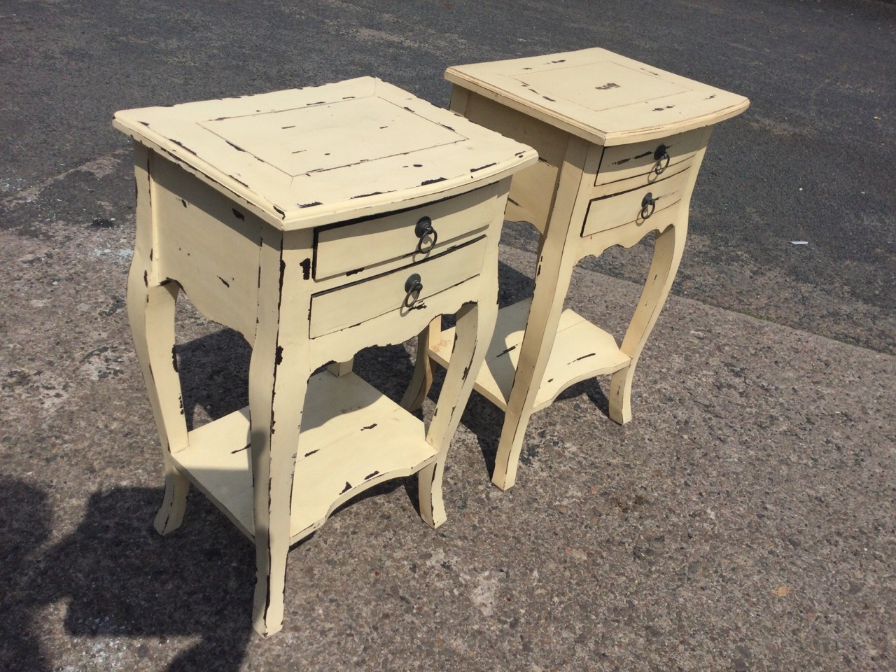 A pair of painted bowfronted bedside tables, the panelled moulded tops above two small drawers - Image 2 of 3