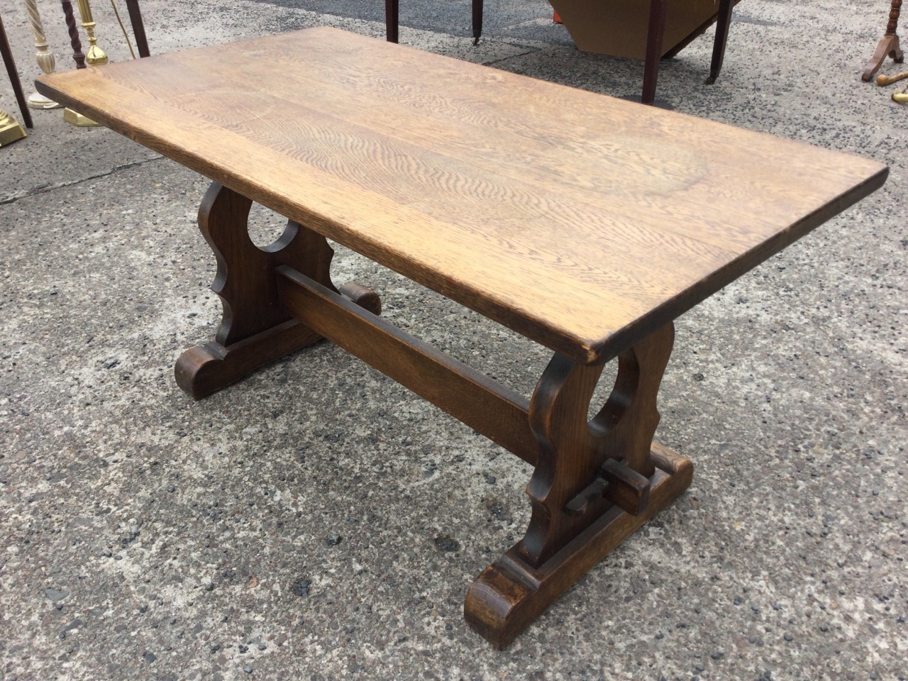 A rectangular oak coffee table on pierced trestle style supports joined by pegged stretcher, with - Image 3 of 3