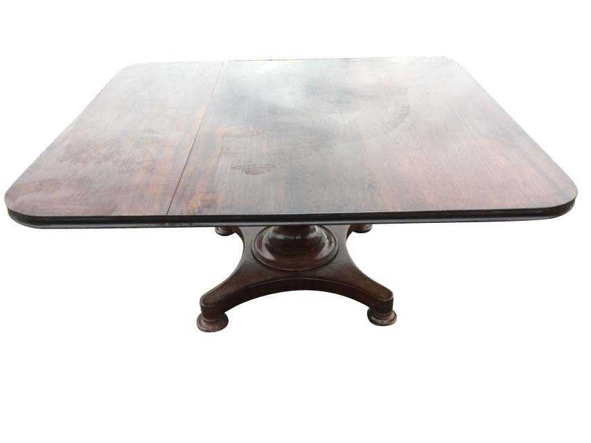 A large nineteenth century walnut breakfast table, the rectangular top with moulded edge raised on