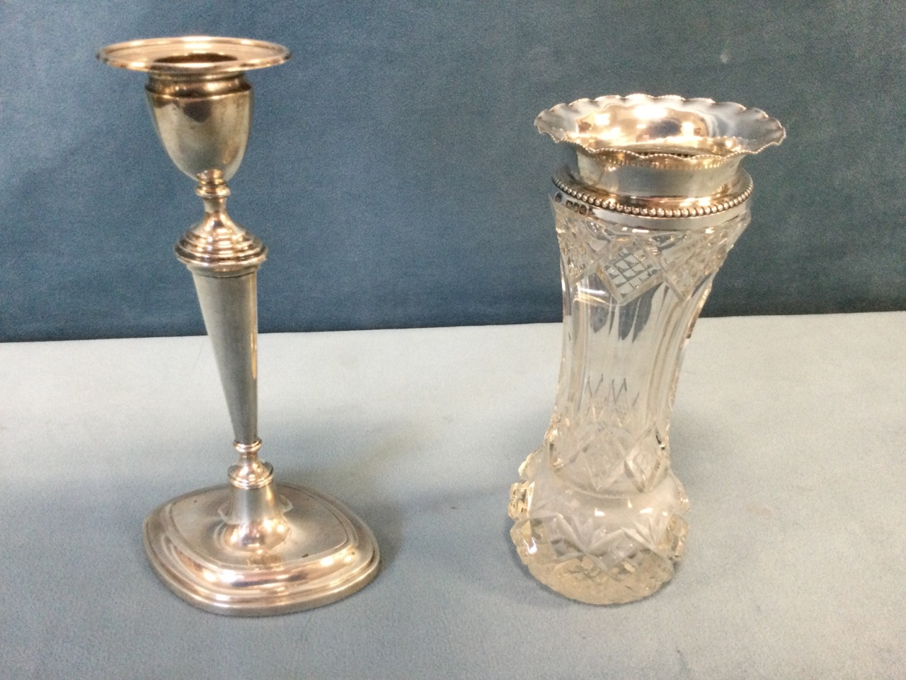 A Victorian cut glass vase with bead mounted waved hallmarked silver mounts - London,1899, William