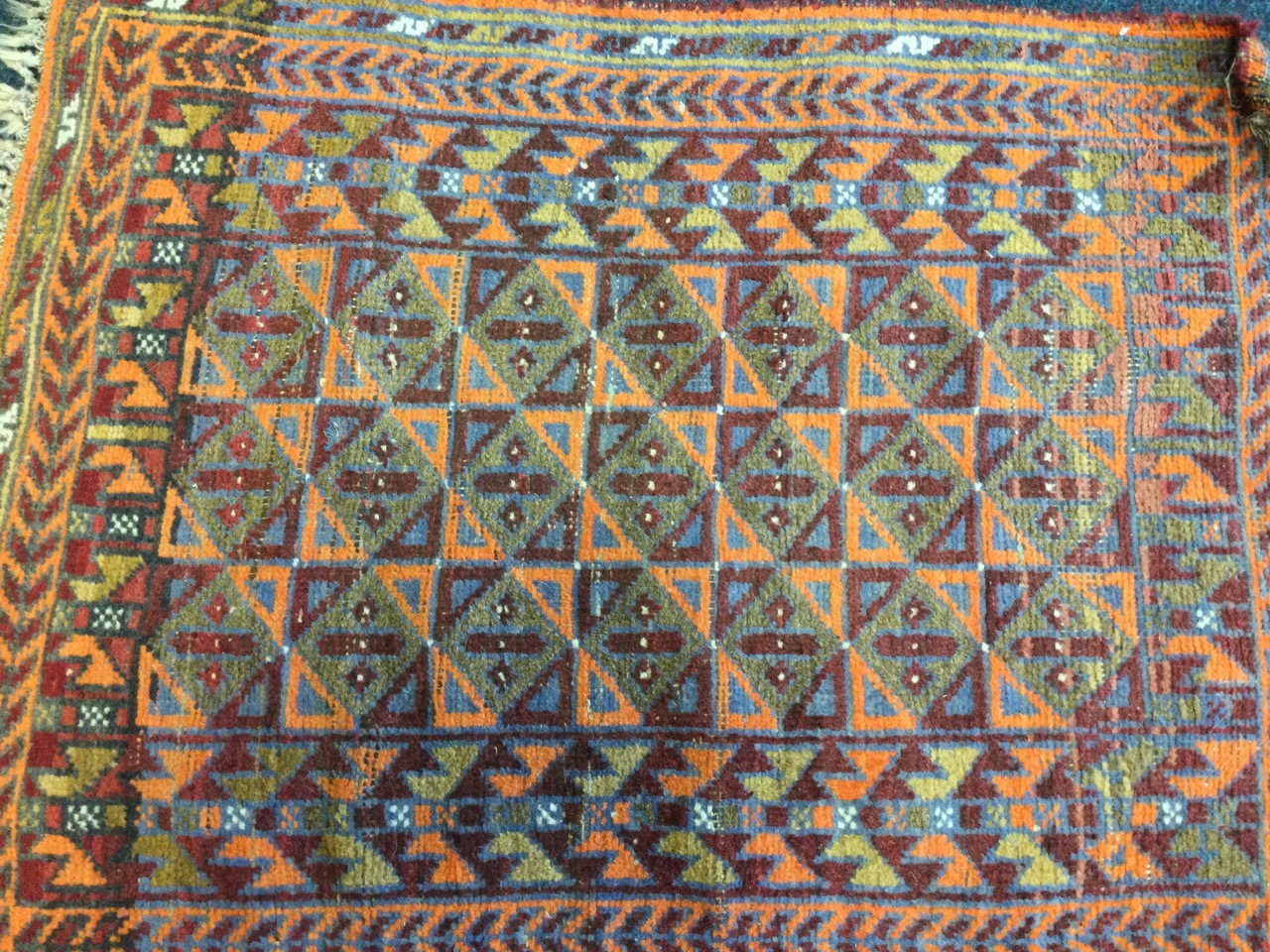 A Turkish rug woven with field of triangular & square panels framed by border of winged bat type - Image 3 of 3
