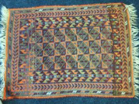 A Turkish rug woven with field of triangular & square panels framed by border of winged bat type