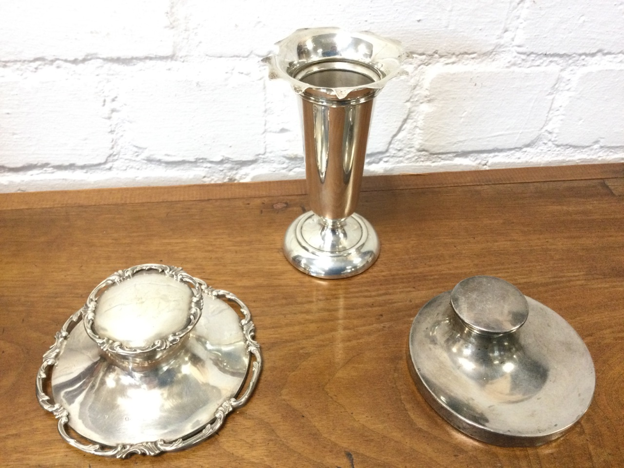 A hallmarked silver trumpet vase with scalloped rim on circular weighted base; a Victorian silver