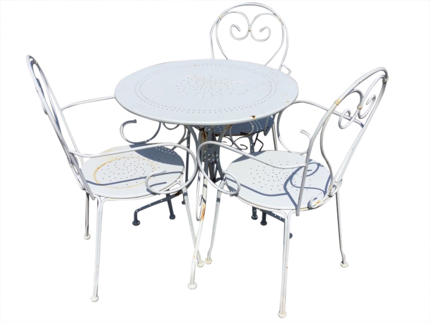A circular white painted metal garden table with three armchairs, the chairs with rounded backs