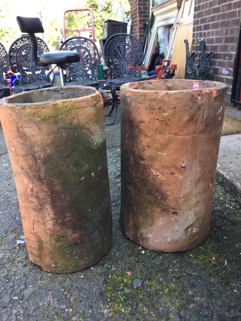 A pair of large tubular terracotta pipes - used as garden planters. (14in x 24in) (2) - Image 2 of 3