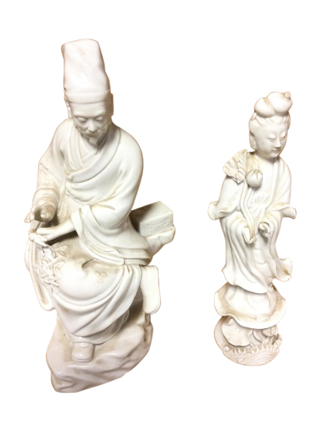 A C20th blanc-de-chin porcelain figure of a seated Chinese gentleman holding leaves; and another
