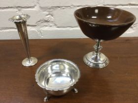 A turned walnut bowl on sterling silver ribbed & embossed stand; a hallmarked silver trumpet vase