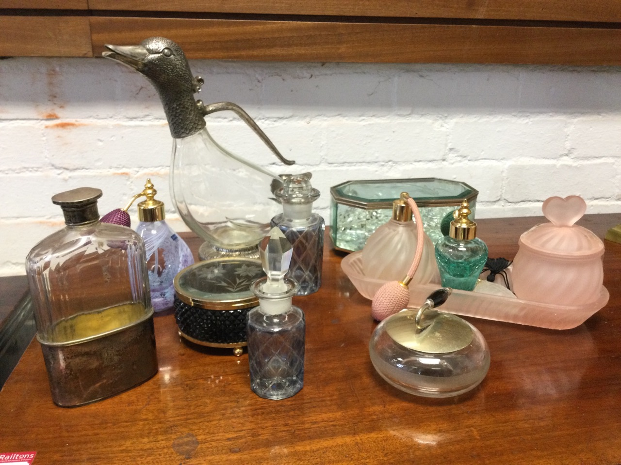A glass claret jug in the form of a duck with silver plated mounts; a faceted glass flask with - Image 3 of 3