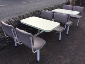 A pair of 70s cafe tables with integral rounded formica tops on tubular metal frames, each with four