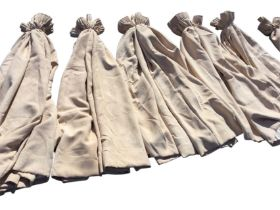 Four pairs of fawn suede type 54in. lined curtains, and one single and another longer 74in. pair. (