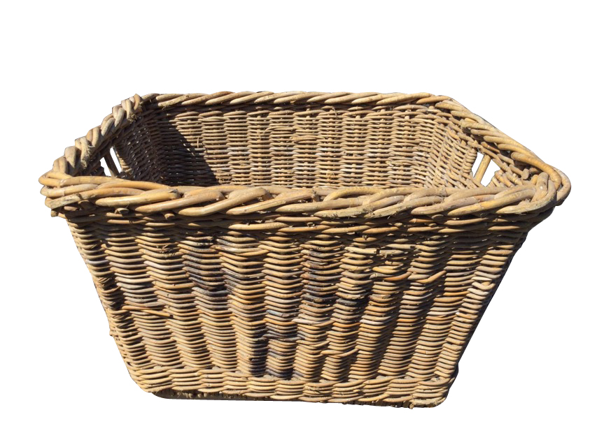 A cane log basket with angled sides, the ends with hand-holes, raised on rectangular batons. (31in x