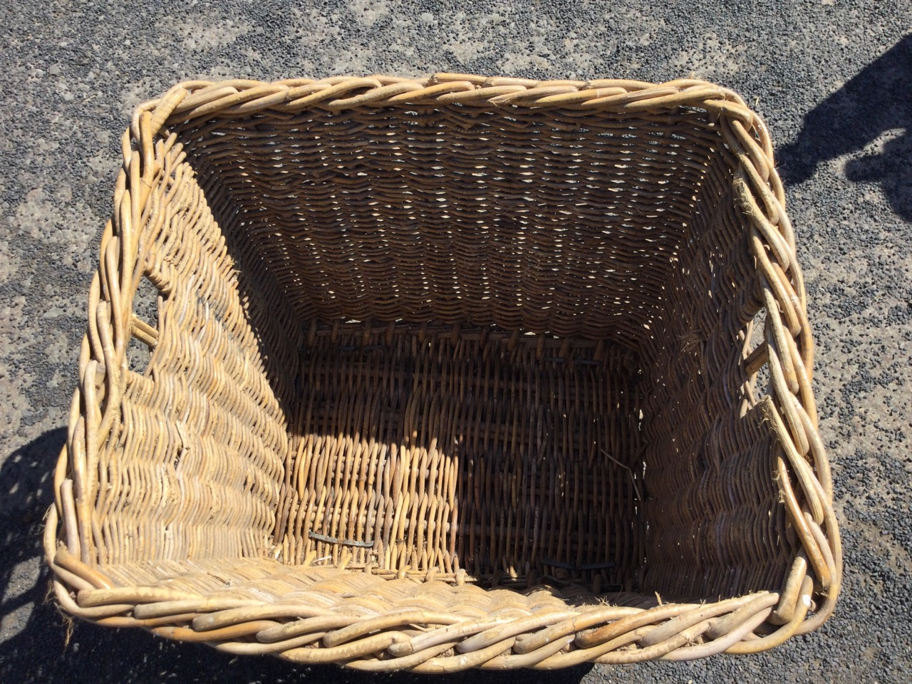 A cane log basket with angled sides, the ends with hand-holes, raised on rectangular batons. (31in x - Image 2 of 3
