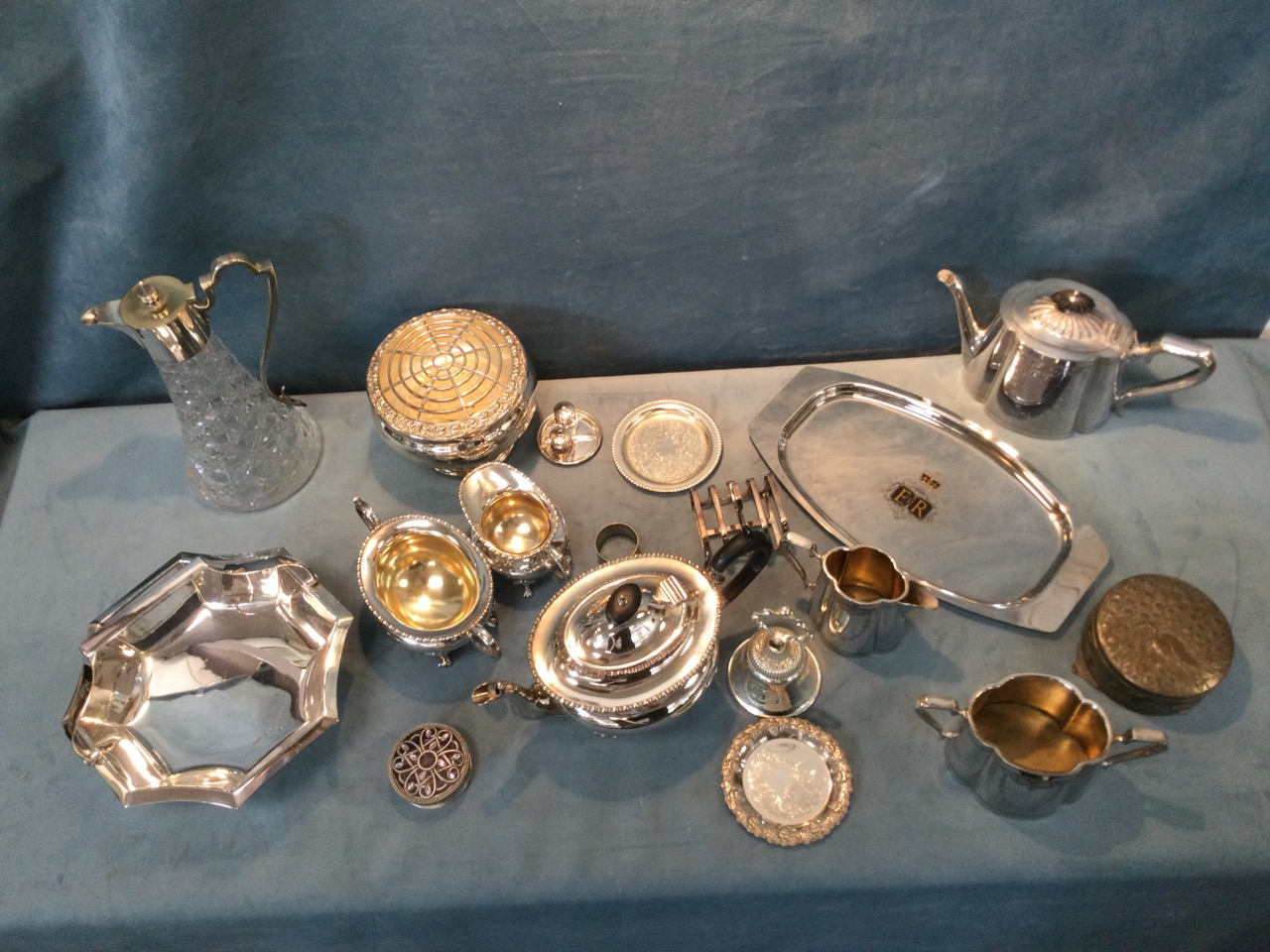 Miscellaneous silver plate including two Edwardian three-piece teasets, a rose bowl, a tapering