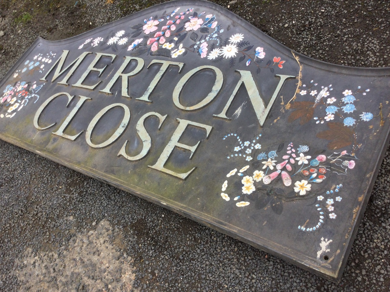 A rectangular sign handpainted & moulded in relief with flowers, in moulded frame. (56in x 26.5in) - Image 3 of 3