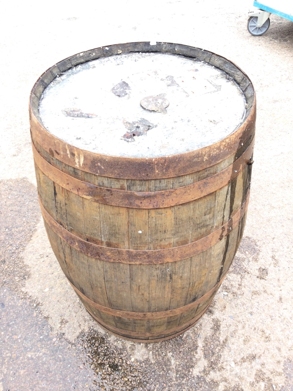 An oak whiskey barrel, the staves bound by six metal riveted strap bands. (34in) - Image 3 of 3