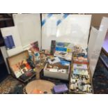 A collection of artists materials including paints, a folding easel, brushes, boxed sets of pastels,