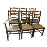 A set of six dowel jointed oak ladderback dining chairs, including two carvers, with arched rails in