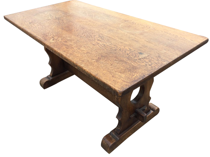 A rectangular oak coffee table on pierced trestle style supports joined by pegged stretcher, with
