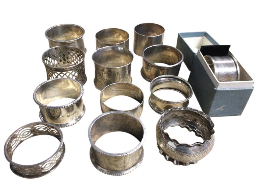 Thirteen hallmarked silver napkin rings - beaded, pierced, plain, engraved, etc. (approx 293g) (13)