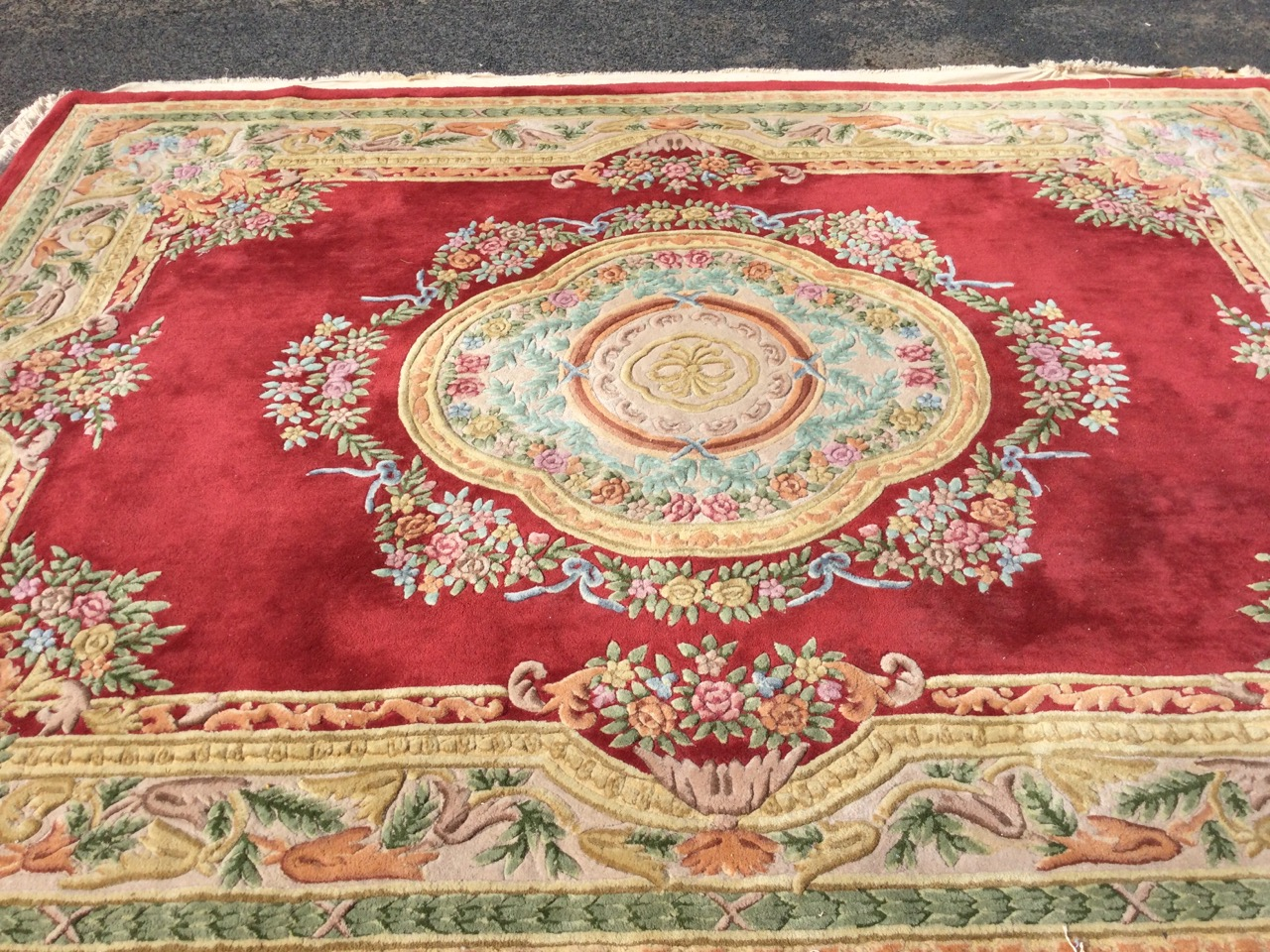 A Chinese thick-pile floral carpet woven with central scalloped medallion framed by ribbon - Image 2 of 3