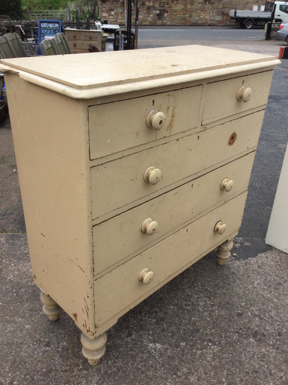 A Victorian painted pine chest of drawers, the rounded moulded top above two short and three long