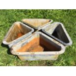 A set of four triangular galvanised corner feed troughs with flat rims. (28in x 17.5in x 11.5in) (