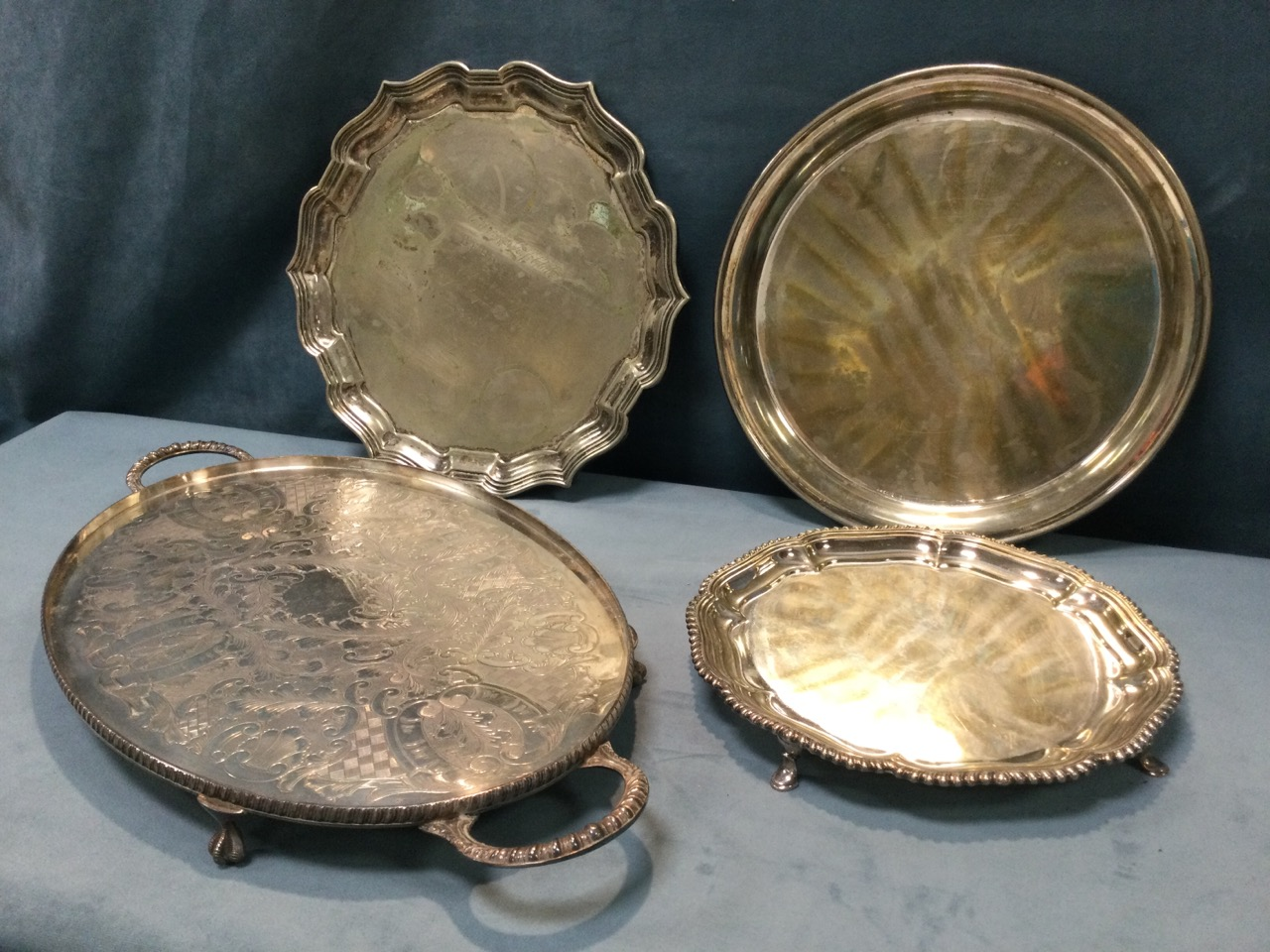 A silver plated scalloped waiter with gadrooned rim on three paw feet; an oval foliate engraved tray - Image 2 of 3