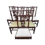 A set of six period Chippendale style mahogany dining chairs, the scalloped back rails with shell