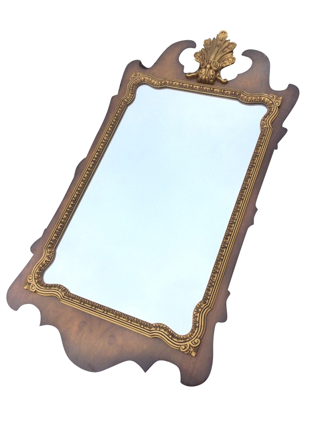 A George II style walnut framed mirror, the pediment with scrolled gilt leaf crest above a shaped