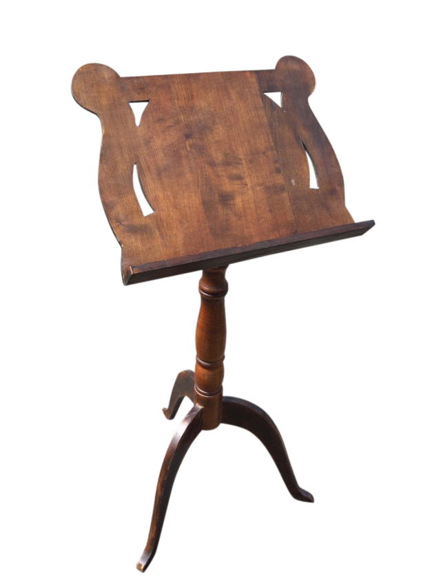 A mahogany music stand with adjustable angled reading platform on rise-and-fall turned column,
