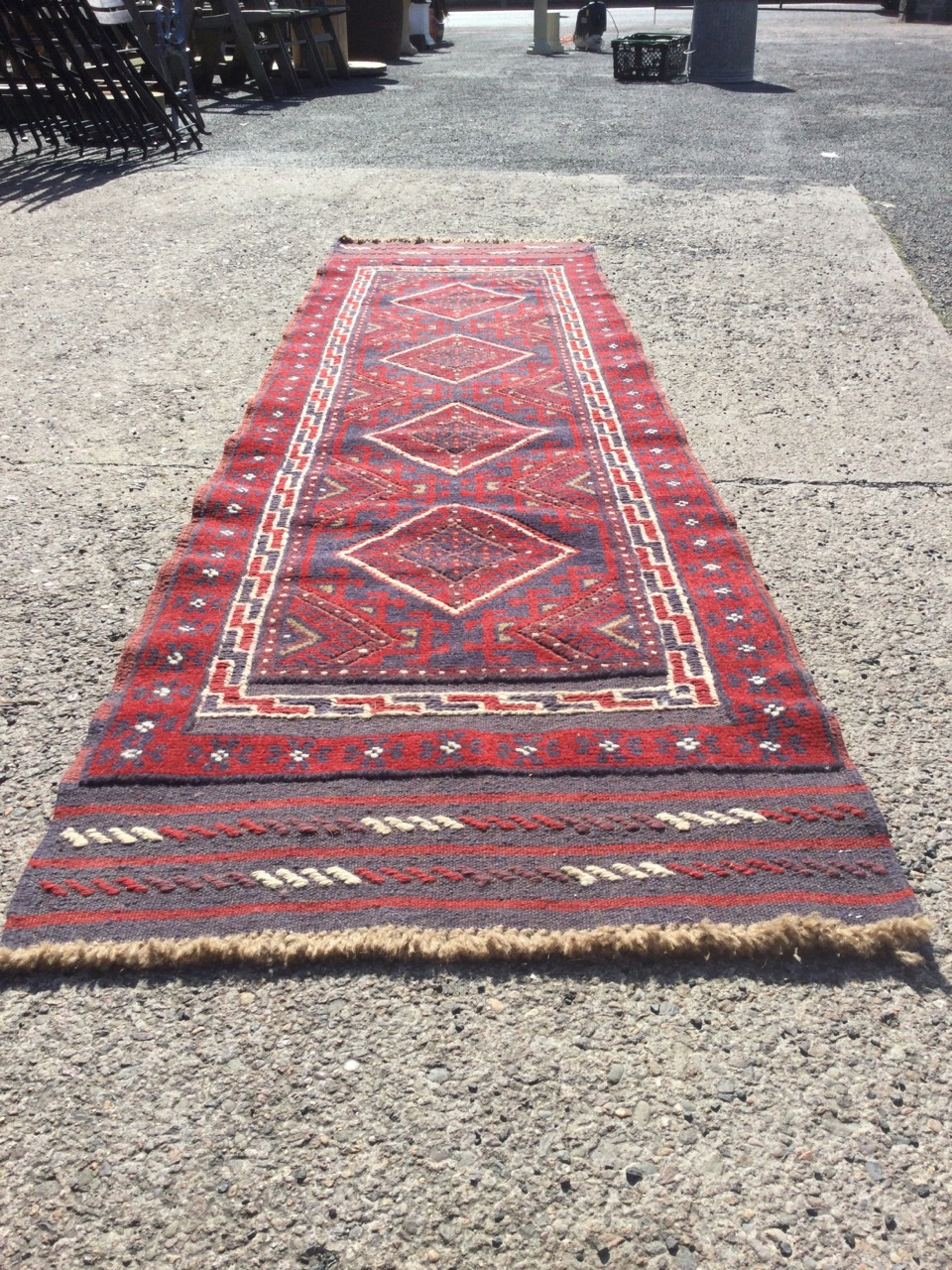 A Turkish runner woven with red field of four diamond shaped medallions with blue hooked borders, - Image 2 of 3
